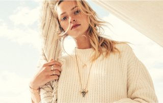 Alex & Ani model wearing layered necklaces